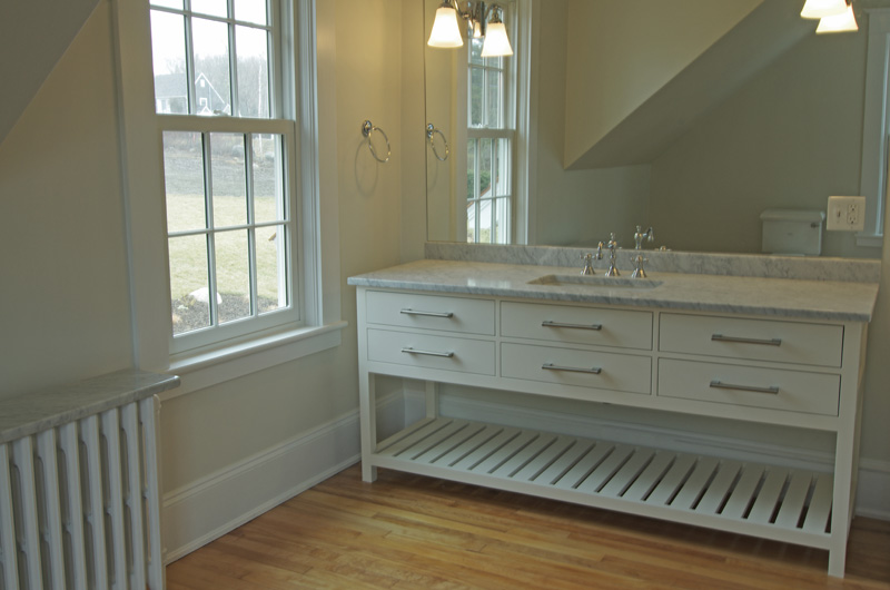 maintain integrity of 1920s house in chester add functionality to kitchen also 6 vanities